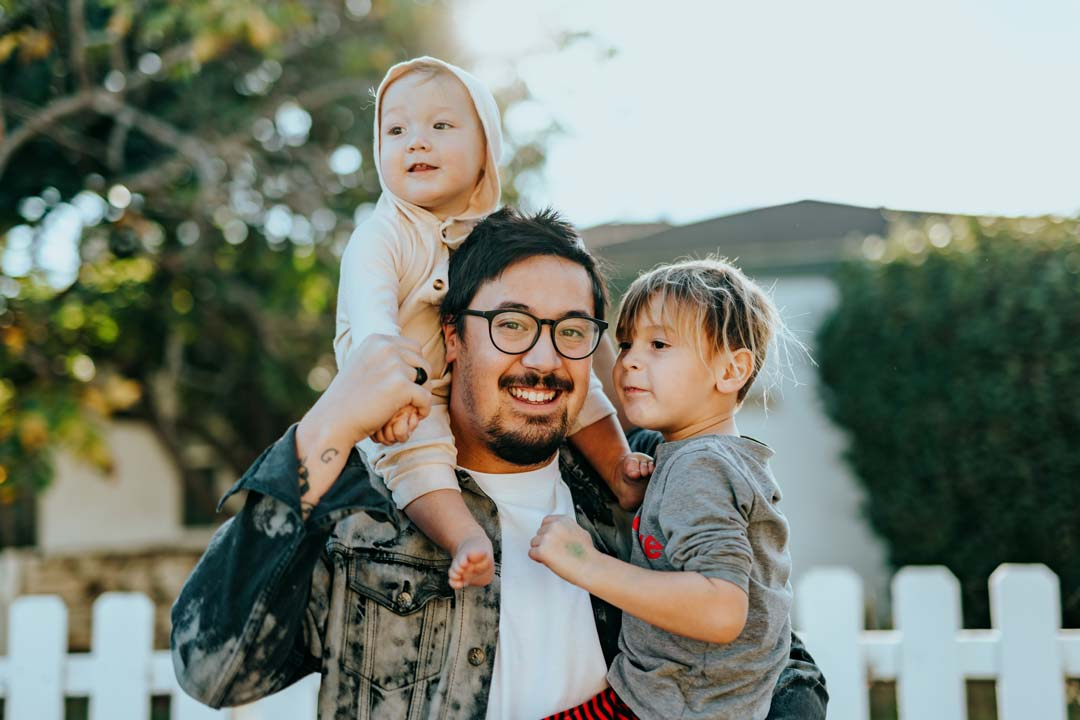 Father holding children