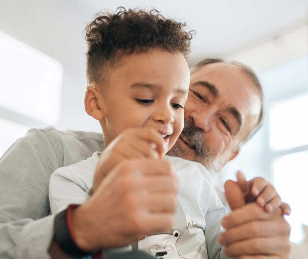 Child and grandfather smiling